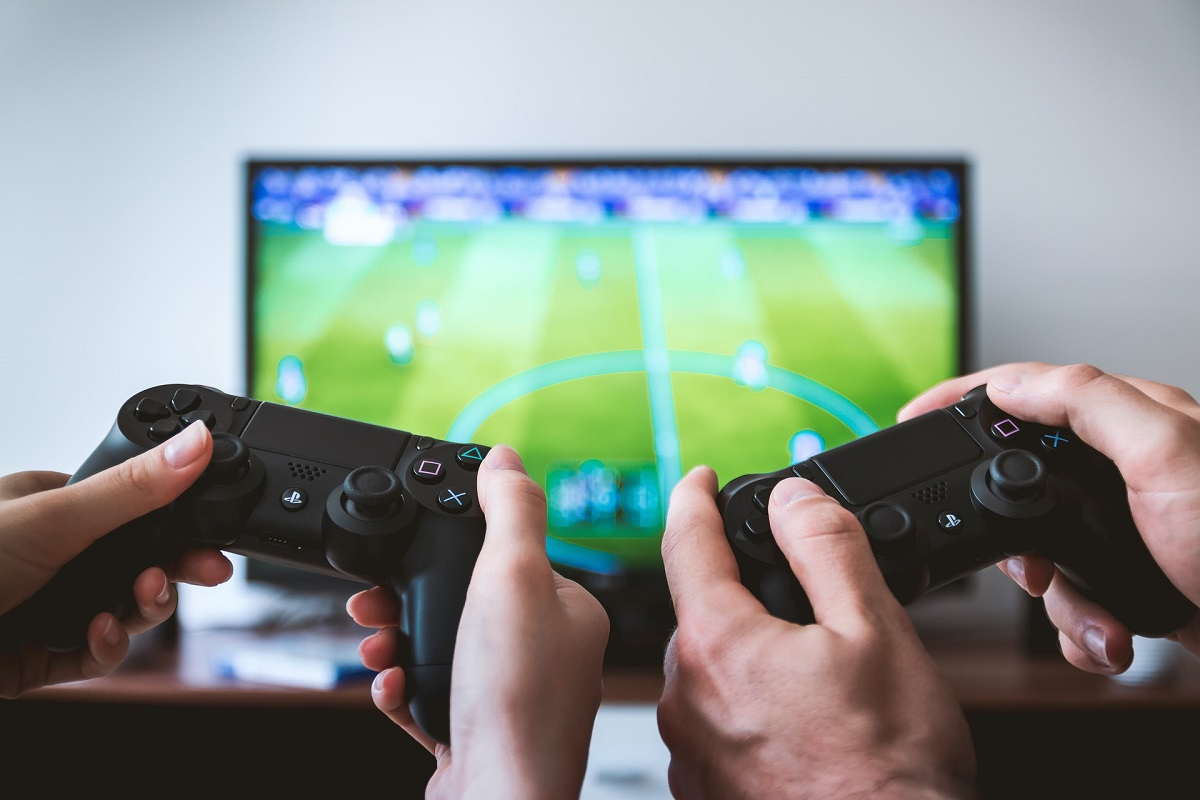 two people playing Sony PS4 game console photo