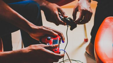 two person using corded controllers photo